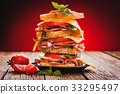 Club sandwich with cheese,basil, tomato, ham 33295497