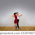 The young boy and girl posing at dance studio 33307667