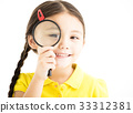 happy little girl with magnifying glass 33312381