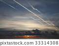 Sunset, clouds and contrails over the sea 33314308