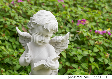 Cupid stucco in the garden 33317710