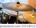 Close up cymbal with drums in background 33318522