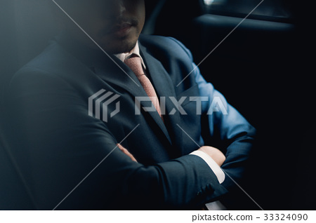 a portrait of businessman crossing his hands in car 33324090