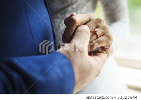 Newlywed Couple Holding Hands Together 33325844