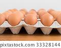 Fresh chicken egg in package 33328144