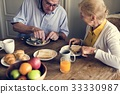 Senior Adult Couple Eat Breakfast 33330987
