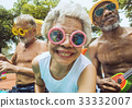 Closeup of diverse senior adults sitting by the pool enjoying summer together 33332007