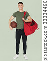 Young adult muscular man holding basketball 33334490