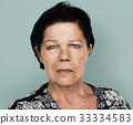 Senior adult woman in moody studio portrait 33334583