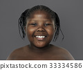 Little african girl smiling shirtless studio portrait 33334586