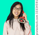 Asian girl talking by phone studio portrait 33334591