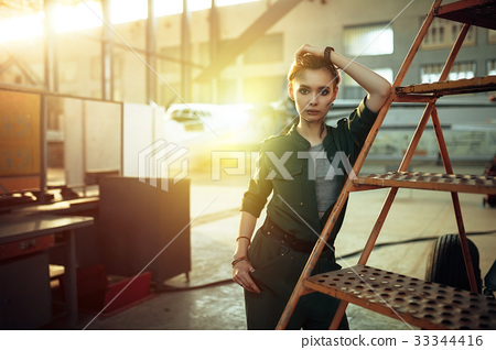 Portrait of modern young woman working  33344416