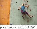girl climbing up the wall 33347520