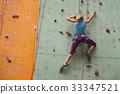 girl climbing up the wall 33347521