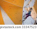 girl climbing up the wall 33347523