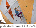 girl climbing up the wall 33347524