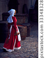 Townswoman in red dress with an apron and chaperone 33348328
