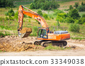 An excavator removing ground on construction site 33349038