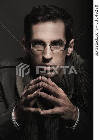 Portrait of handsome man in glasses 33349220