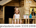 lovely girl play with watering can in a tree house 33351008