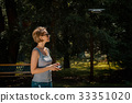 Woman holding radio controller and flying a drone 33351020