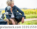 Active senior woman wearing a blue denim jacket 33351550