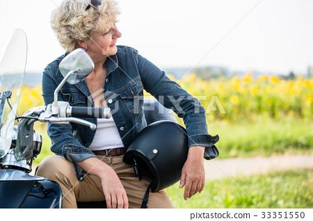 Active senior woman wearing a blue denim jacket 33351550