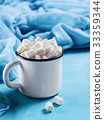 Marshmallows on blue background with copyspace 33359344
