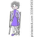 Senior woman putting on crutches 33364563