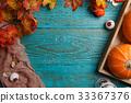 Blue table with halloween pumpkin 33367376