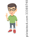 Caucasian little boy showing victory gesture. 33369740