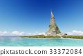 Peak of a rocky mountain on a tropical island sea 33372084