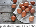 Fresh chicken brown eggs on rustic wood, organic 33372765