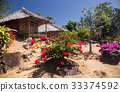 wooden bungalows in tropical garden  33374592