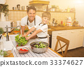 Father with son washes vegetables before eating 33374627