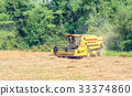 Combine harvester on a soy field 33374860