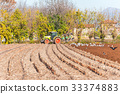 Tractor plowing a field 33374883