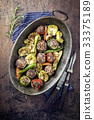 Rice Meatballs with Vegetable in Copper Pod 33375189