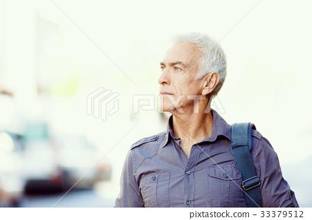 Handsome mature man outdoors 33379512