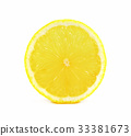 Juicy yellow slice of lemon on white background 33381673