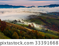 rising fog covers rural fields in mountains 33391668