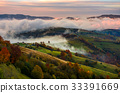 rising cloud covers rural fields in mountains 33391669