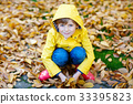 happy cute little kid boy with autumn leaves 33395823