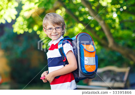 little kid boy with school satchel on first day to 33395866