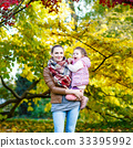 mother and her little daughter at beautiful autumn 33395992
