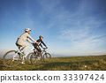 Happy mountainbike couple outdoors have fun 33397424