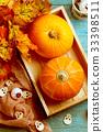 Halloween pumpkins, brown cloth, skulls 33398511