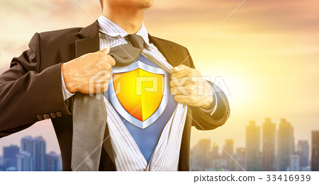 businessman in superhero costume with shield 33416939