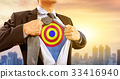 businessman in superhero costume with dart target  33416940