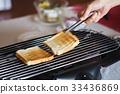 Toast bread on toaster 33436869